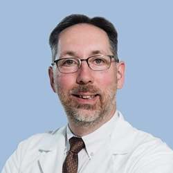 Dr. Mark Povroznik, vice president of Quality at UHC, Grill Master